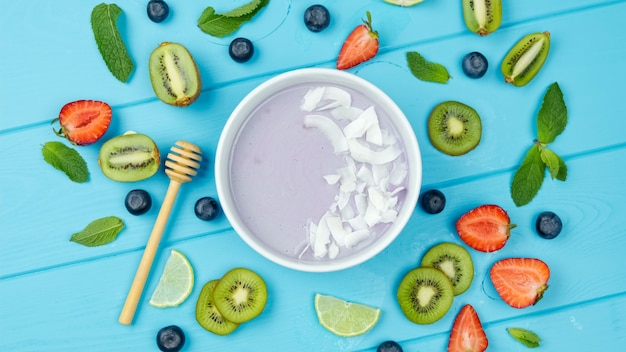 Spirulina seaweed smoothie with chia berries and fruits healthy food. flat lay