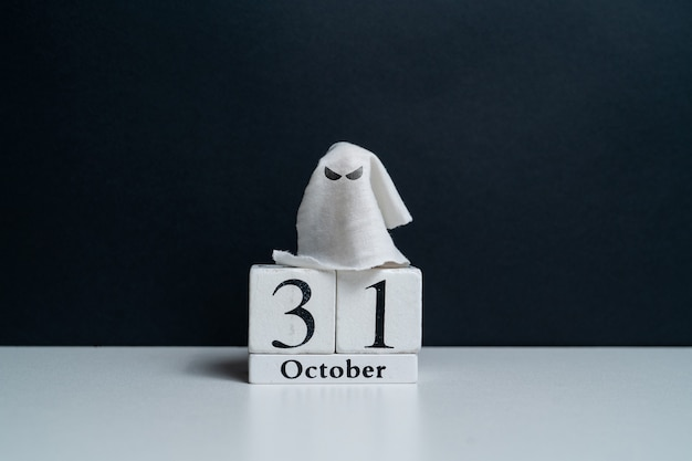 Spiteful ghost next to october calendar with copy space halloween holiday