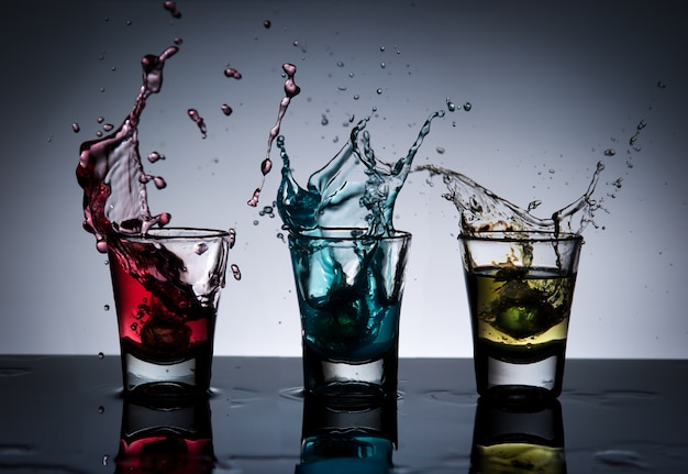 Splash of alcohol cocktail and glass