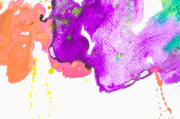 Splash of colorful watercolor on white background