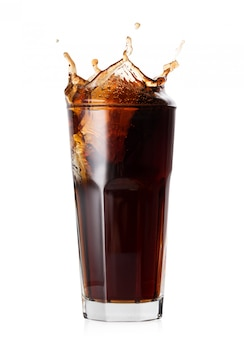 Splash in faceted glass of cola