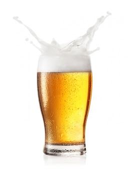 Splash of foam in a glass of beer