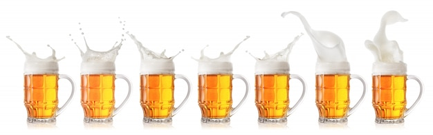 Splash of foamy light beer in mug