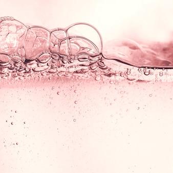 化粧品保湿剤フローラルウォーターミセルトナーローションまたはエマルジョン抽象的な背景のスプラッシュ