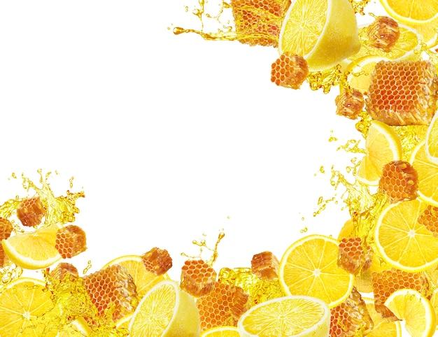 Всплеск лимона и меда с копией пространства
