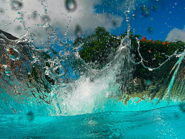 Splash in the pool after a dip air bubbles formed in the water