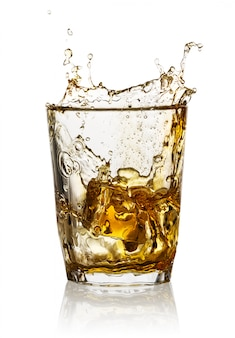 Splash in a transparent glass of whiskey