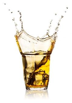 Splash in transparent glass of whiskey