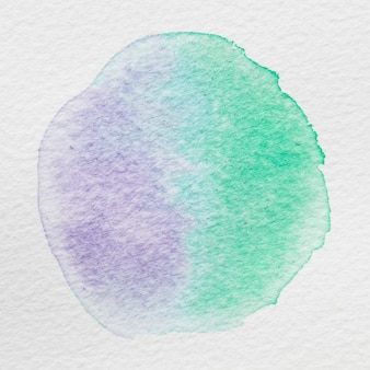 Splash of water color on white canvas paper