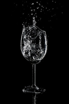 Splash of water in a glass on a black background