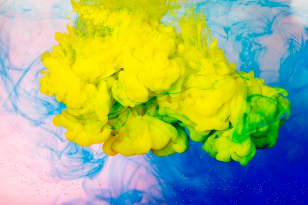 Splashes of bright paint in water