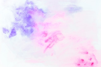 Splashes of violet and magenta watercolor