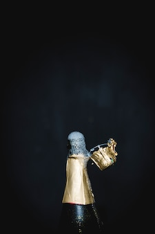 Splashing bottle of champagne