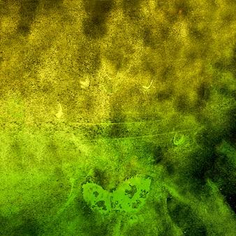 Splatted yellow and green holi powder