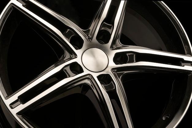 Spokes of a black alloy wheel on black