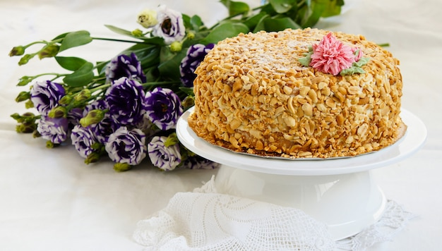 Sponge cake with peanuts and butter cream