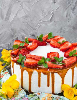 Sponge cake with strawberry. wedding cake. birthday cake. caramel. holiday.