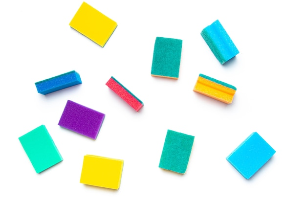 Sponge for washing dishes on a white surface . household items. clean dishes. help in the kitchen. colored sponges. isolated surface. copy space.