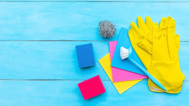 Sponges and cleaning brushes on a light blue surface