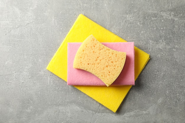 Sponges for washing dishes on grey