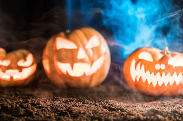 Spooky carved pumpkins with smoke