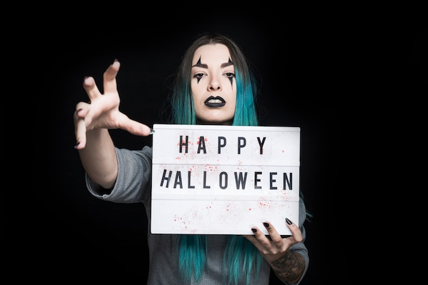 Spooky female with signboard