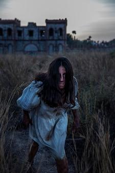 Spooky female zombie outdoors