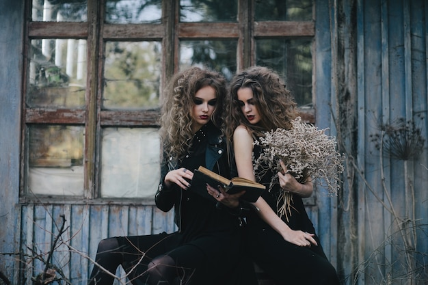 Spooky girls reading a spell