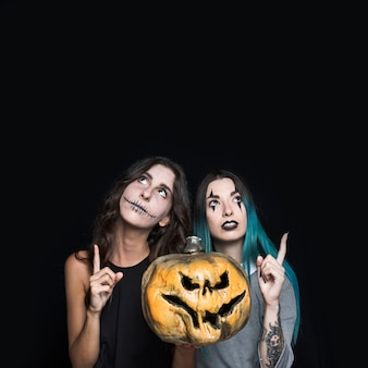 Spooky girls with jack-o-lantern
