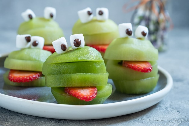 Spooky green kiwi monsters for halloween party