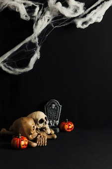 Spooky halloween decoration with skulls and cobweb