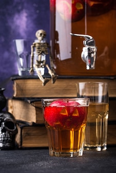 Spooky halloween drink autumn apple cider or lemonade