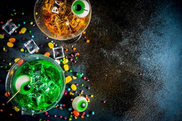 Spooky halloween green, orange martini cocktails