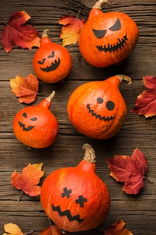 Spooky halloween pumpkins with autumn leaves