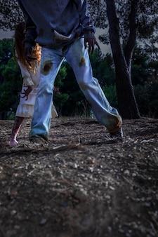 Spooky male zombie outdoors