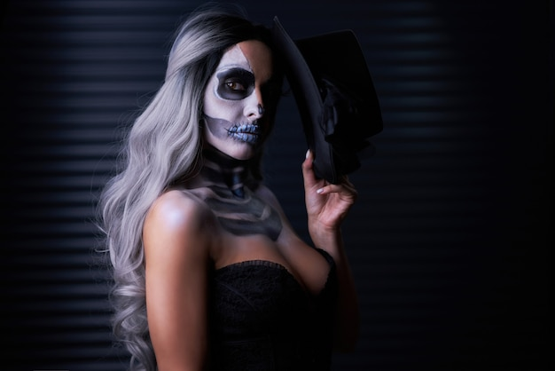Spooky portrait of woman in halloween gothic makeup