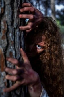 Spooky zombie hands on a tree