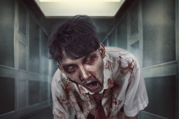 Spooky zombie man with bloody face on the dark place