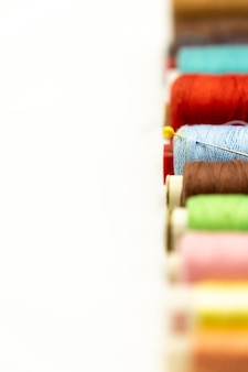 Spools of sewing thread straight to the right with white background