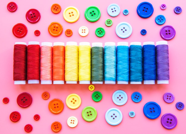 Spools of thread and buttons on the colors of the rainbow