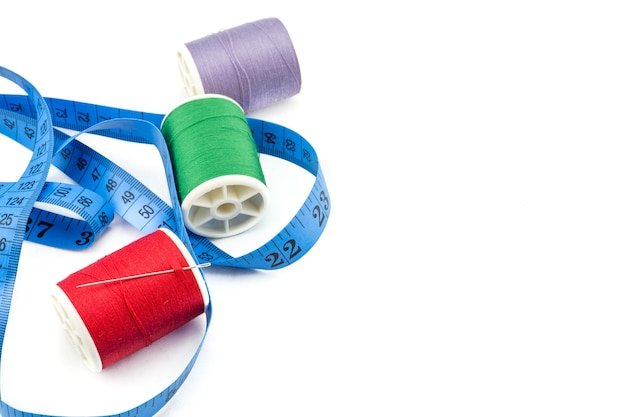 Spools of thread and meter on white background