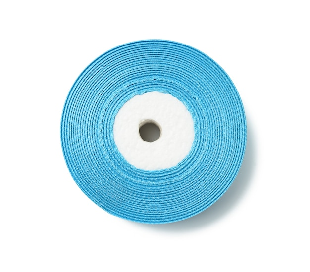 Spools with blue satin ribbon on white