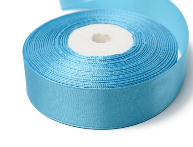 Spools with blue satin ribbon