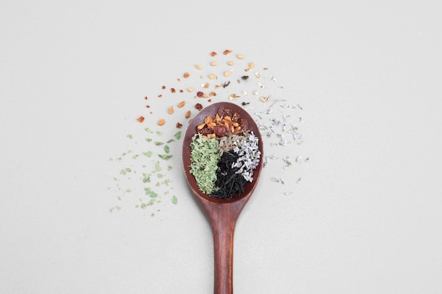 Spoon aroma with spices on white