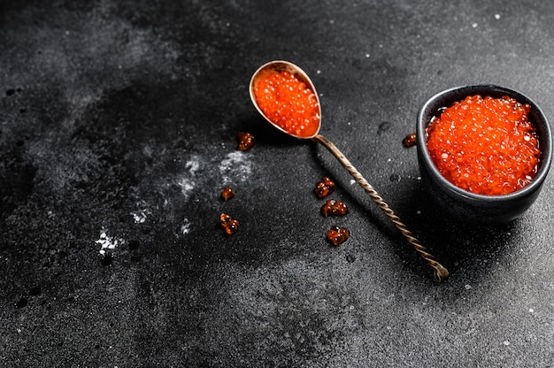 Spoon of exquisite red caviar. top view.