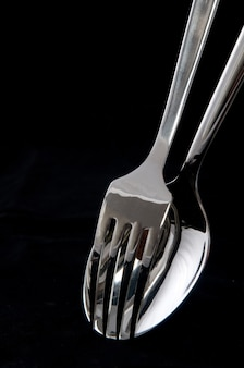 Spoon and fork in black background
