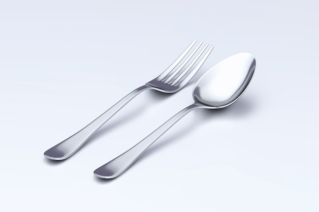 Spoon and fork isolated on white surface