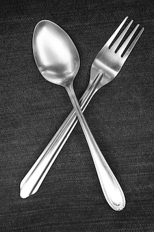Spoon and fork placed on blue and white handkerchiefs