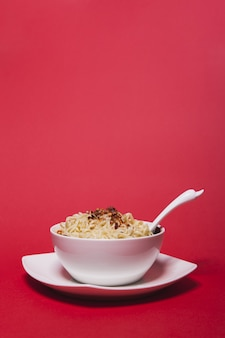Spoon in bowl with noodles
