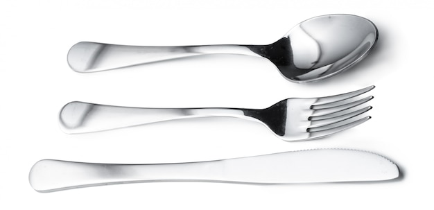 Spoon, knife and fork isolated on white surface